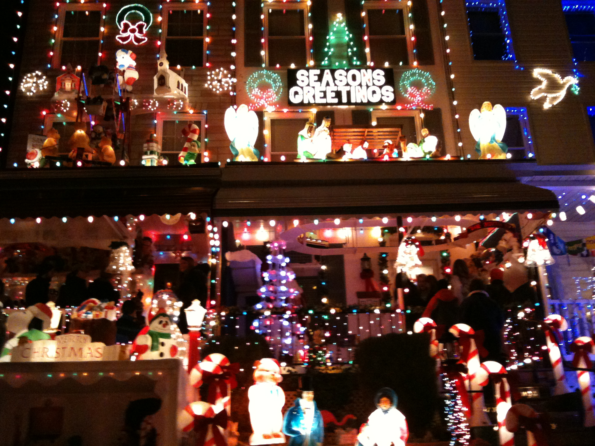 december brings the joy of the holidays as one house plugs in their christmas lights on 34th street in hampden baltimore - Baltimore 34th Street Christmas Lights